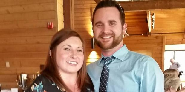 Shelby Slagle with her husband Ryan, who received US$1.35 million after settling a lawsuit with the hospital group. Photo / Facebook