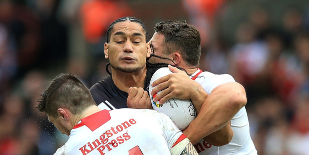 Loading Martin Taupau runs the ball up in the Kiwis win over England. Photo /Getty