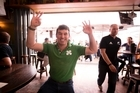 Ireland fan Mark Moynihan celebrates Ireland's win over the All Blacks while watching the game at O'Hagans Irish bar. Photo/Dean Purcell