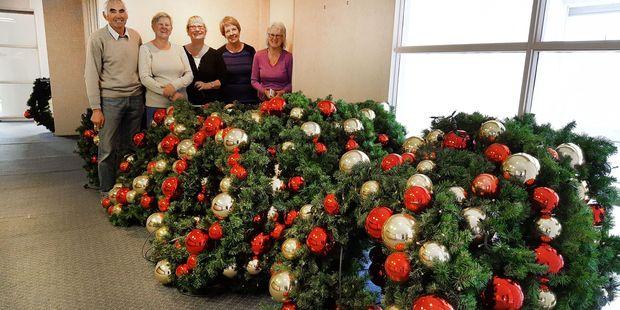 Tony Haslett, Gemma Kleyn, Robin Haslett, Sheila Bouma and Merilynn Clean of the Mount Art Group with some of the wreaths they helped refurbish. Photo/Supplied