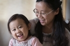 Michelle Cheng with her two year old daughter, Chelsey Cheng who has just been diagnosed with a rare form of stage 4 cancer. Photographed in their New Lynn home on Tuesday. 8 November 2016. New Zealand Herald photograph by Nick Reed.