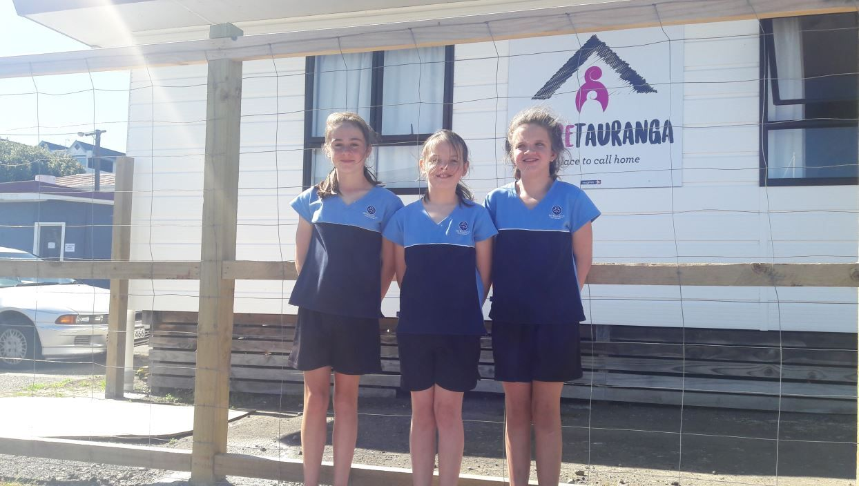 Fiona Stanelun, 12, Rose Tustin, 11, and Opal Nilsen, 12, from the Arataki Division Girl Guides, raised money and goods through a bake sale to gift to the homeless families at Whare Tauranga. Photo/supplied
