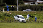 Police at the scene near Waiuku after a woman was found in a paddock with stab wounds. Photo / Dean Purcell