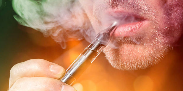 Vaping on electronic cigarettes is another new behaviour that's split public health in two. Photo / 123RF