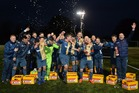 East Kilbride celebrate their record breaking win with 27 crates of beer, courtesy of Edwin van der Sar and Dutch-club Ajax. Photo / Getty