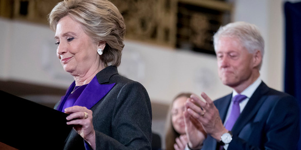 Democratic presidential candidate Hillary Clinton, left, accompanied by her husband former President Bill Clinton speaking at the New Yorker Hotel. Photo / AP
