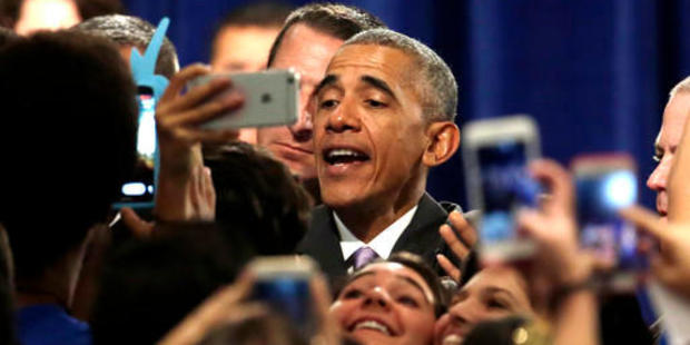 President Barack Obama poses for photographs with the crowd after speaking about the Affordable Care Act (ACA), which Trump has vowed to appeal. Photo / AP