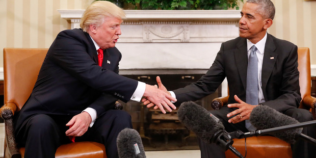 Loading President Barack Obama shakes hands with President-elect Donald Trump in the Oval Office of the White House in Washington. Photo / AP