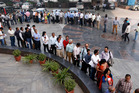 People queue outside a bank to withdraw money in India's capital, New Dehli. Photo / AP