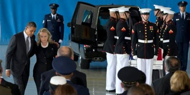In this September 14, 2012 file photo, Barack Obama and Hillary Clinton during the Transfer of Remains Ceremony marking the return of the four Americans killed in Benghazi, Libya. Photo / AP