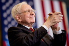 Berkshire Hathaway Chairman and CEO Warren Buffett applauds at an election rally. Photo / AP
