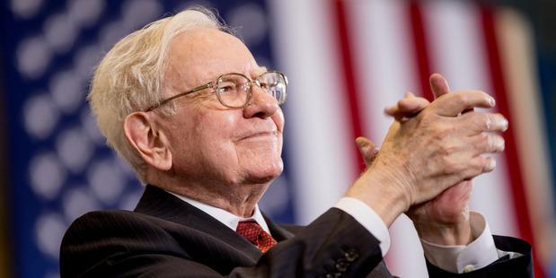 Berkshire Hathaway Chairman and CEO Warren Buffett applauds at an election rally. Photo / AP