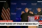Source: CNN.   Donald Trump is rushed offstage during a Nevada rally amid security alert.