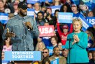 Cleveland Cavaliers star LeBron James speaks as Democratic presidential candidate Hillary Clinton claps during a campaign rally at Cleveland Public Hall in Cleveland. Photo / AP