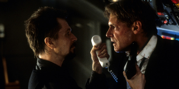 Gary Oldman aiming gun at Harrison Ford in a scene from the film 'Air Force One', 1997. Photo / Getty