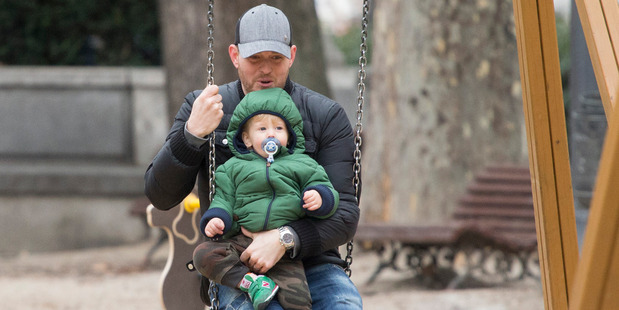 Michael Buble on a swing with his son Noah, February 12, 2015 in Madrid. Photo / Getty