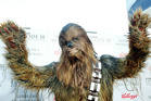 Chewbacca actually speaks English with a British accent.