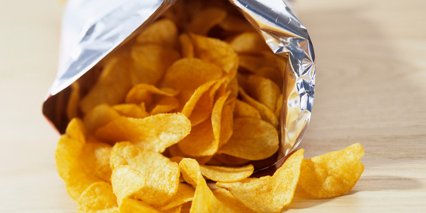 Old chips may not be very crispy but they are safe to eat after the expiry date. Photo / Getty Images.