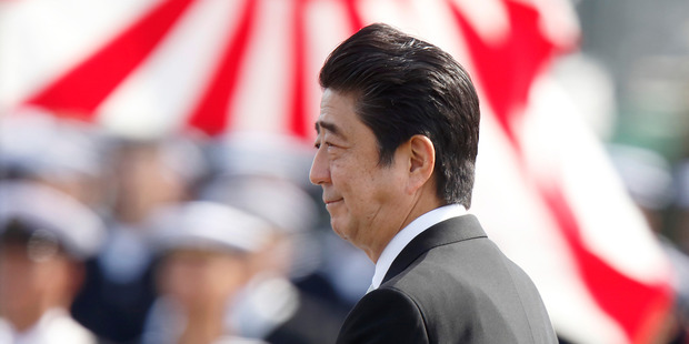 Japanese Prime Minister Shinzo Abe is looking to improve relations with Vladimir Putin. Photo / AP