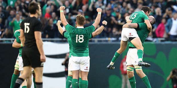 Loading Ireland players celebrate their 40-29 victory. Photo / Getty