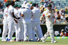 David Warner of Australia leaves the field after being run out by Temba Bavuma of South Africa. Photo / Getty