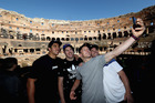 Anton Lienert-Brown, Brodie Retallick, Damian McKenzie and Ryan Crotty take advantage of a photo opportunity while visiting the Colosseum in Rome. Photo / Getty Images