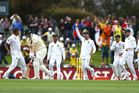 Vernon Philander of South Africa celebrates with teammates after taking the wicket of Adam Voges. Photo / Getty