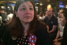 Democrat supporter Amanda Richards is feeling low as the results come in. Photo / Melissa Nightingale