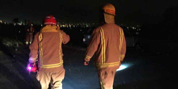 Avondale fire crew off to inspect a bonfire. Photo / Sarah Harris