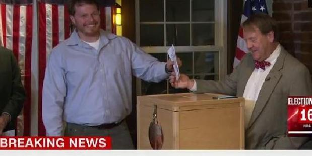 It all started so well in Dixville Notch, where a smiling voter waited to cast his ballot, the first on election day. Photo / CNN