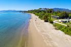 Duane Major and Adam Gard'ner would like to keep a 6ha site at  Tukurua Beach in Kiwi hands. Photo / Bayleys