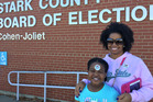 Crystal Johnson with 7-year-old daughter Dauson at the Stark County Board of Elections office in Canton, Ohio. Photo / Chris Reed