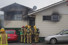 Firefighters at the house on Kaikoura St. Photo/Nick Reed