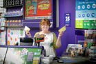 Belinda Sands from Greerton Lotto Store is hoping to retire as she and other punters  grab the chance to win big in Wednesday night's 44m draw. Photo/Andrew Warner.