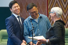 NEW KIWIS: From Left, James and his father Fang Fang Lui are congratulated by mayor Steve Chadwick for becoming offical Kiwis. PHOTO/STEPHEN PARKER