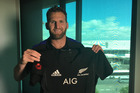 All Blacks captain Kieran Read with the new All Blacks jersey featuring an embroidered poppy for the Test against Italy.