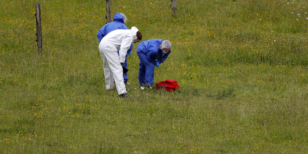 Police at the scene where a woman was found in a paddock with stab wounds. Photo / Dean Purcell