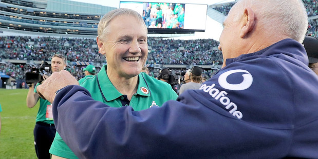 WELL DESERVED: Ireland head coach Joe Schmidt and team manager Mick Kearney celebrate after beating the All Blacks in Chicago. PHOTO: photosport