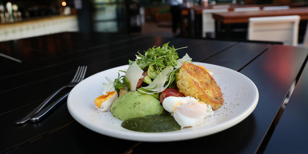 Agria potato hash, kransky, avocado, free-range poached egg, ciabatta at the Glass Goose. Photo / Getty Images