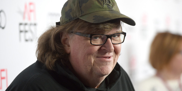 Filmmaker Michael Moore believes Trump didn't want the presidency in the first place. Photo / AP