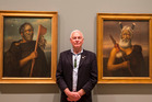 Benjamin Pittman is flanked by paintings of his ancestors, Tamati Waka Nene (left) and Eruera Maihi Patuone. Photo / Peter Meecham