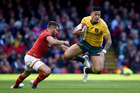 Australia's Israel Folau, right, is tackled by Wales' Rhys Webb during the Autumn International match at the Principality Stadium, Cardiff, Wales. Photo / AP.
