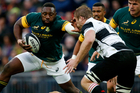 The Barbarians' Martin Muller, right, gets a face off from South Africa's Tendai Mtawarira during the Killik Cup rugby match South Africa versus Barbarians. Photo / AP.