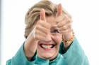 Hillary Clinton gives two thumbs up as she takes the stage to speak at a rally. Photo / AP