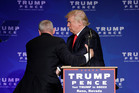 Members of the Secret Service rush Republican presidential candidate Donald Trump off the stage at a campaign rally in Reno, Nevada. Photo / AP