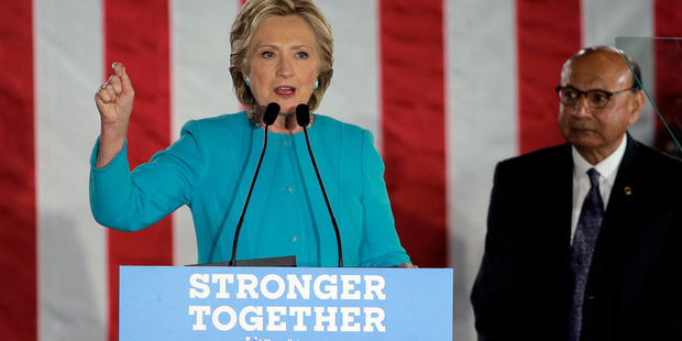 Democratic presidential candidate Hillary Clinton, left, addresses an audience with Khizr Khan, right, a Gold Star father, whose son Army Captain Humayun Khan was killed in Iraq. Photo / AP