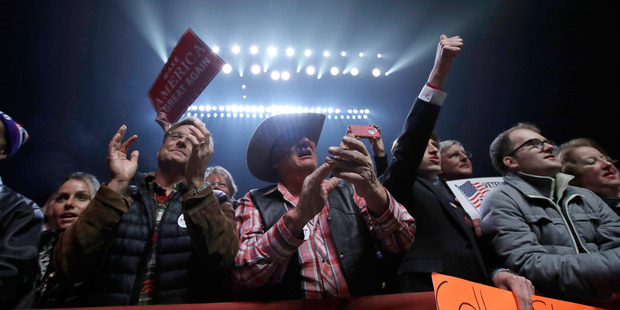 Donald Trump's supporters cheer at a rally. Photo / AP