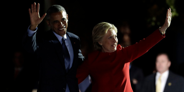 Democratic presidential candidate Hillary Clinton takes the stage and waves with President Barack Obama during a campaign event at Independence Mall. Photo / AP
