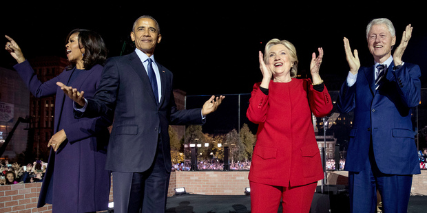 Hillary Clinton, second from right, is joined on stage by first lady Michelle Obama, left, President Barack Obama, second from left, and former President Bill Clinton. Photo / AP