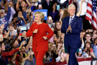 Hillary Clinton is upbeat as she takes the stage with her husband, Bill, in Raleigh, North Carolina, yesterday. Photo / AP